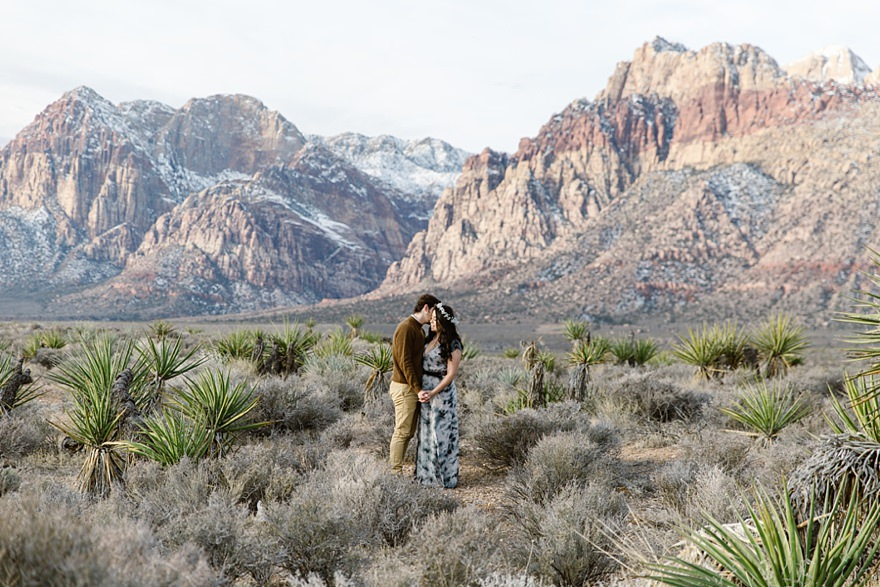 couple standing amongst cacti at red rocks canyon in Las Vegas for their engagement wedding photoshoot